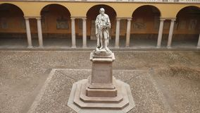 Alessandro Volta statue at University of Pavia, PV, Italy, fast panoramic shot.  stock video