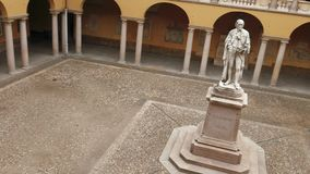 Alessandro Volta statue at University of Pavia, PV, Italy, tilted panoramic.  stock footage