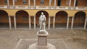 Alessandro Volta statue at University of Pavia, PV, Italy, zoom out.  stock video footage