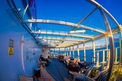 ALESUND,挪威- 2018年4月09日:享受看法的室外观点的人在一次Hurtigruten巡航旅行期间,从甲板 免版税库存照片