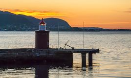 Lighthouse in Norwegian Sea in Alesund, Norway. Alesund is a famous resort and tourist city in Norway Royalty Free Stock Image