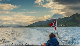 Pleasure motorboat in Norwegian Sea near Alesund, Norway. Alesund is a famous resort and tourist city in Norway Stock Image