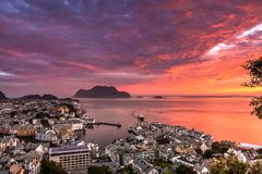 City Seascape with Aerial View of Alesund Center, Islands, Atlantic Ocean and Colorful Sky at Gorgeous Sunset stock photo
