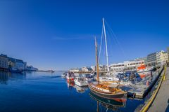 ALESUND, NORWAY - APRIL 04, 2018: Outdoor view of Alesund port town on the west coast of Norway, with some boats sailing. At the entrance to the Geirangerfjord royalty free stock photos