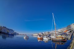 ALESUND, NORWAY - APRIL 04, 2018: Outdoor view of Alesund port town on the west coast of Norway, with some boats sailing. At the entrance to the Geirangerfjord royalty free stock photography