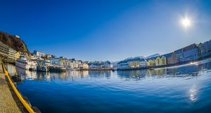 ALESUND, NORWAY - APRIL 04, 2018: Outdoor view of Alesund port town on the west coast of Norway, with some boats in the. Shore in a gorgeous blue sky with sun royalty free stock photos