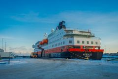 ALESUND, NORWAY - APRIL 04, 2018: Outdoor view of Hurtigruten coastal vessel KONG HARALD, is a daily passenger and stock images