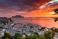 City Seascape with Aerial View of Alesund Center, Islands and Atlantic Ocean at Gorgeous Sunset royalty free stock image