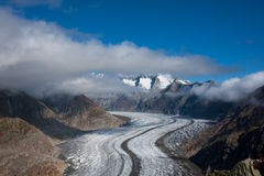 Aletsch glacier. Melting Aletsch glacier. Blue sky with some clouds. Aletsch region. Switzerland Royalty Free Stock Photo
