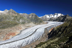 Aletsch Glacier. And the summits of Fiescher Gabelhorn, Schönbühlhorn, Wannenhorn in Valais, Switzerland, on a bright morning stock photography