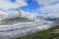 Aletsch Glacier in the Alps. Aletsch glacier with a cloudy sky between mountains in the Swiss Alps, Valais, Switzerland stock image