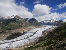 Aletsch Glacier With Clouds. The Aletsch glacier is the longest glacier in Europe and liesin the canton of Wallis, Switzerland an is a UNESCO world heritage site royalty free stock photography