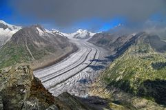 Aletsch Glacier - glacier in the Alps mountains, landmark attraction in Switzerland. Aletsch Glacier - the largest glacier in the Alps mountains, landmark Royalty Free Stock Image