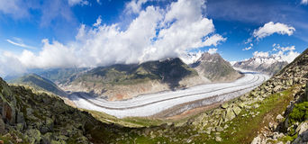 Aletsch glacier Panorama. Extraordinairy panorama of the breathtaking Aletsch glacier as seen from the Bettmer alp in switserland, on a sunny day with clouds in stock photo