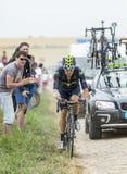 Alex Dowsett Riding auf einer Kopfstein-Straße - Tour de France 2015 Stockbild