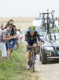 Alex Dowsett Riding on a Cobblestone Road - Tour de France 2015 Stock Image