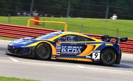 Alex Figge of K-Pax. Alex Figge races the McLaren 12C GT3 for the K-Pax sponsored Race team at the professional motorsports racing event, International Motor Stock Photography