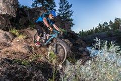 Alex Grediagin rides the Deschutes River Trail. In Bend, Oregon stock photos