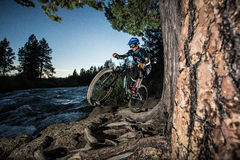Alex Grediagin rides the Deschutes River Trail. In Bend, Oregon royalty free stock image