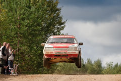 Alex Ivanov drives a  red Lada Zhiguly Stock Photography
