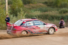 Alex Kononov drives a  Mitsubishi Lancer Royalty Free Stock Photos