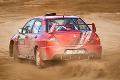 Alex Kononov drives a  Mitsubishi Lancer Royalty Free Stock Image