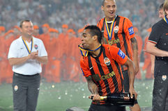 Alex Teixeira with a medal in the teeth Royalty Free Stock Photos