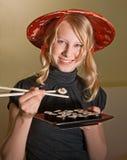 Alexa disfruta de su comida Imagenes de archivo