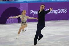 Alexa Scimeca Knierim и Крис Knierim Соединенных Штатов выполняют в программе пар события команды катаясь на коньках короткой Стоковая Фотография RF