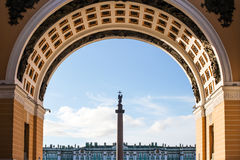 Alexander column on Palace Square through the arch. View of alexander column on palace square through the arch in Saint Petersburg Stock Image