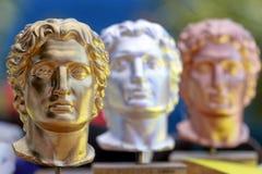Alexander de Grote standbeelden in goud, zilver en brons Stock Afbeelding