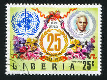Alexander Fleming and tree mallows. LIBERIA - CIRCA 1973: stamp printed by Liberia, shows WHO Emblem, Alexander Fleming and tree mallows, circa 1973 Royalty Free Stock Images