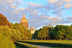 Alexander garden and sunlit St. Isaac's Cathedral on a summer ev. Ening in Saint-Petersburg Stock Image