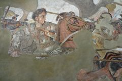 Alexander the Great versus Darius. Pompeii, Italy - April 1, 2017: Ancient roman mosaic of Alexander the Great in battle against Darius, from Pompeii site stock photos
