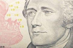 Alexander Hamilton enfrenta em um macro de dez notas de dólar, 10 usd, unidos Imagem de Stock Royalty Free