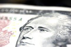 Alexander Hamilton - Ten Dollar Bill. Macro shot of the eyes from Alexander Hamilton (1755-1804) on a $10 bill. Differential focus with copy-space royalty free stock photo