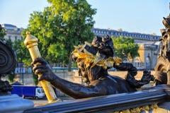 Alexander III bridge in Paris,  nymph of Seine, dawn rays Stock Photos