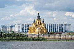 Alexander Nevsky Church on the background of the stadium built for the world Cup. Russia, Nizhny Novgorod, 22 Jul 2018 Royalty Free Stock Photo