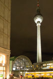 Alexander Platz Station & TV Tower at Night. Berlin's Alexanderplatz Station and TV Tower Fernsehturm illuminated on a busy but dark autumn evening with Tram Stock Image