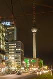 Alexander Platz & TV Tower at Night. Berlin's Alexanderplatz and TV Tower Fernsehturm illuminated on a busy but dark autumn evening Royalty Free Stock Photos