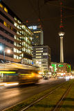 Alexander Platz & TV Tower at Night. Berlin's Alexanderplatz and TV Tower Fernsehturm illuminated on a busy but dark autumn evening with Bus passing in front Stock Image