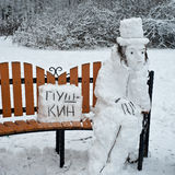 Alexander Pushkin famous poet is made from snow. (the text on the plate: PUSHKIN Stock Photography
