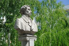 Alexander Pushkin monument in Orel, Russia with green willows on Royalty Free Stock Images
