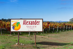 Alexander Valley welcome sign. Welcome sign to Alexander Valley California with beautiful colorful vineyards in the background Royalty Free Stock Image