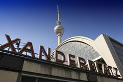Alexanderplatz station sign and the TV Tower in Berlin Royalty Free Stock Image