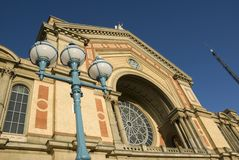 Alexandra Palace. A detail of the facade of the Great Hall at Alexandra Palace in North London, with part of the BBC antenna visible on the right Stock Images