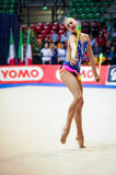 Alexandra Soldatova performs with clubs Royalty Free Stock Photos
