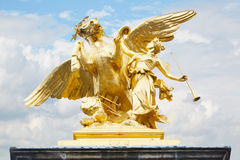 Alexandre III bridge golden statue in Paris Stock Photo
