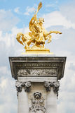 Alexandre III bridge golden statue in Paris Stock Image