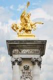 Alexandre III bridge golden statue in Paris Stock Image